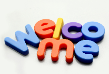 magnetic letters spelling out welcome