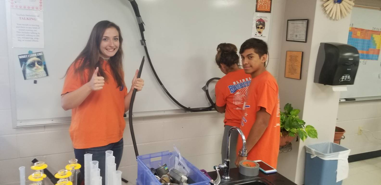 Physics students building rollercoaster