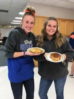 FCS students posing with pancakes
