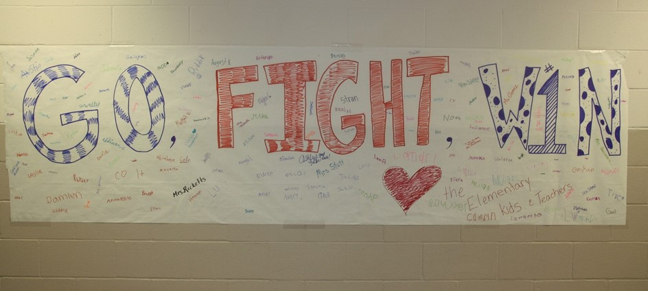 go fight win banner signed by elementary students